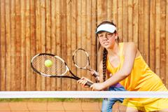 Tennis player playing match on the court in summer Stock Photos