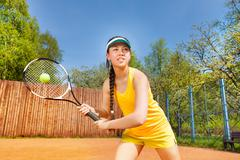 Female tennis player in action outdoor Stock Photos