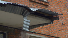 Launched Building Fragment, Piece of Canopy, Raining, Closeup Stock Footage