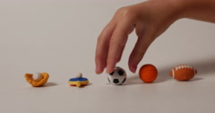 Child Choosing to Play Soccer Shown by Sport Symbols, 4K Stock Footage