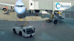 Airplane standing after arriving at airport dock Stock Footage