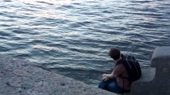 Young Man Looking at River Stock Footage