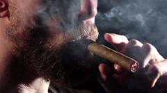 Detail of a person smoking cigar. Black. Close up. Slow motion - stock footage
