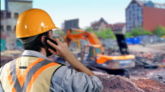 4K Construction Worker, Foreman on Mobile Phone at Job Site with Hardhat Helmet - stock footage