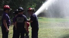 Firemen testing new equipment, 300 feet stream Stock Footage