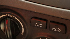 Man includes car air conditioner. close-up Stock Footage