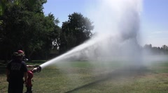 Firemen testing new equipment, directing spray Stock Footage