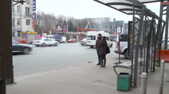 Moscow. Fall. Citry Street. Bus Stop. Couple of People Waiting the Bus. Parking Stock Footage