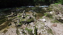 4K. Wild Radovna river flows in Vintgar Gorge and stone pyramids. Stock Footage