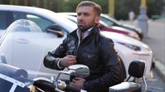Biker Zipper Leather Jacket Sitting on Motorcycle Stock Footage
