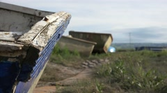 Boats washed up on land, ship grave yard creepy cut away Stock Footage