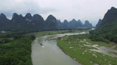 AERIAL FLY OVER OF LOCAL BOAT IN LI RIVER NEAR YANGSHUO CHINA Stock Footage