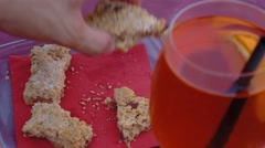 People picking pieces of sbrisolona cake at Mantua aperitivo Stock Footage