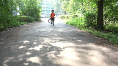 Boy with Bicycle in summer Park Stock Footage