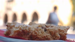 Detail of sbrisolona traditional Mantua cake with Ducal Palace background Stock Footage