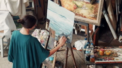Aerial view of an artist in her studio Stock Footage