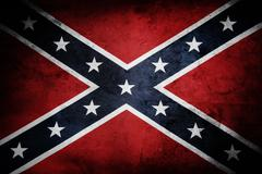 Closeup of grungy Confederate flag - stock photo