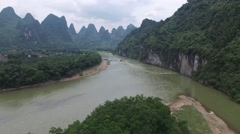 AERIAL FLY OVER LOCAL BOAT IN LI RIVER GUILIN CHINA Stock Footage