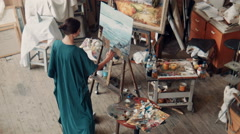 Wide view of an artist in her studio Stock Footage