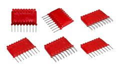 Old red microchip on a white background isolated. - stock photo