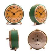 Old green alarm clock with orange dial. Peeling paint. Dirty clock. - stock photo