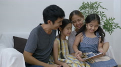 4K : Happy Asian family playing game online on digital tablet with daughters Stock Footage
