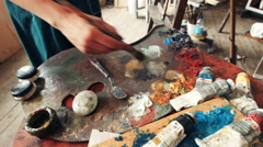 Woman artist mixing oil paint on a palette Stock Footage