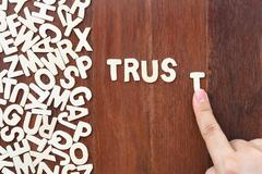 Word trust made with block wooden letters Stock Photos