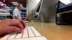 Woman sending message for her friend inside Apple store with 4k resolution. Stock Footage