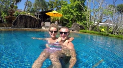 Young Couple Taking Selfie with GoPro in Resort Swimming Pool - stock footage