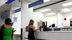 Woman picking up her prescription medicine inside Walmart pharmacy Stock Footage