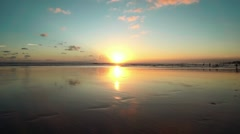 Sunset beach with wet sand reflecting the sky, Bali, Seminyak Stock Footage
