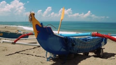 Traditional blue jukung boats on Bali beach Stock Footage