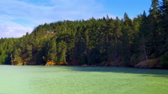 4K Beautiful Turquoise Green Water and Forest Coastline Pacific North West Coast Stock Footage