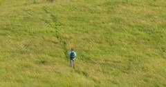 Hiker on a Field Stock Footage