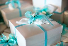 Decorative gift-wrapped party favor in a box Stock Photos