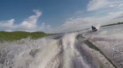 Waves of watercraft - stock footage