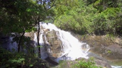 Close approach to waterfall, Phuket. Thailand, South East Asia. Slow motion Stock Footage