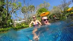 Cheerful Couple Having Fun with GoPro in Swimming Pool on Vacation - stock footage