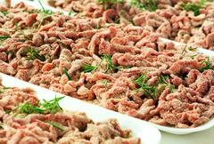 Trays of breaded strips of raw beef Stock Photos