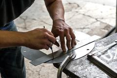 Metalworker making precision measurement Stock Photos