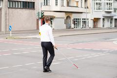 Young Blind Man Holding Stick Crossing Road Kuvituskuvat