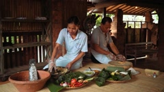 Cooking in traditional balinese kitchen - cutting and grinding Stock Footage