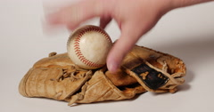 Man Pick Up Baseball on Old Mitt Remembering the Game on White, 4K - stock footage