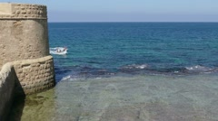 Seascape between the walls of Acre (Israel),on a calm sea. Stock Footage