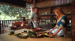 Cooking class in traditional balinese kitchen with brick oven Stock Footage