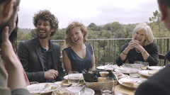 Family dining outdoors at restaurant - stock footage