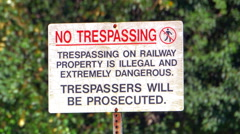 4K No Trespassing, Private Property, Danger Warning at Rail Road Train Track Stock Footage