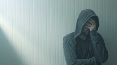 Miserable hopeless troubled man in hooded jacket Stock Footage