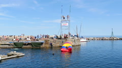 A sunny day with exciting activities in the harbor Stock Footage